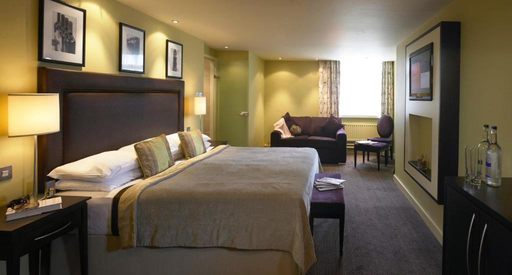 A bed or beds in a room at Manchester Airport Stanley Hotel, BW Signature Collection