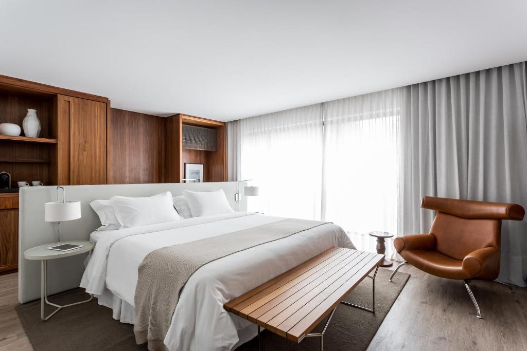 Cama ou camas em um quarto em Nomaa Hotel