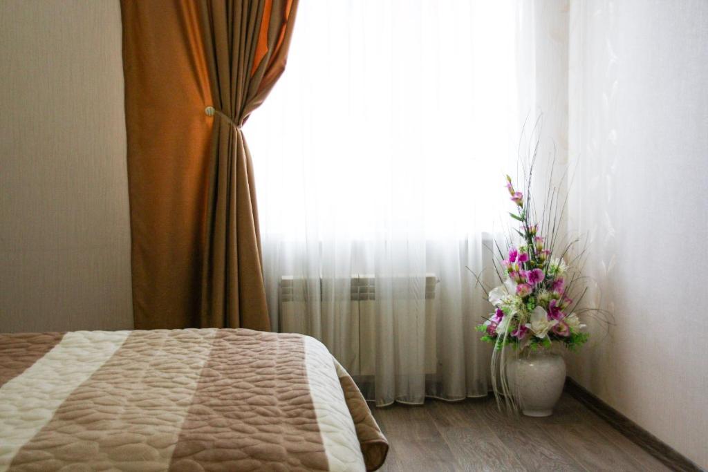 Кровать или кровати в номере Отель Элегант