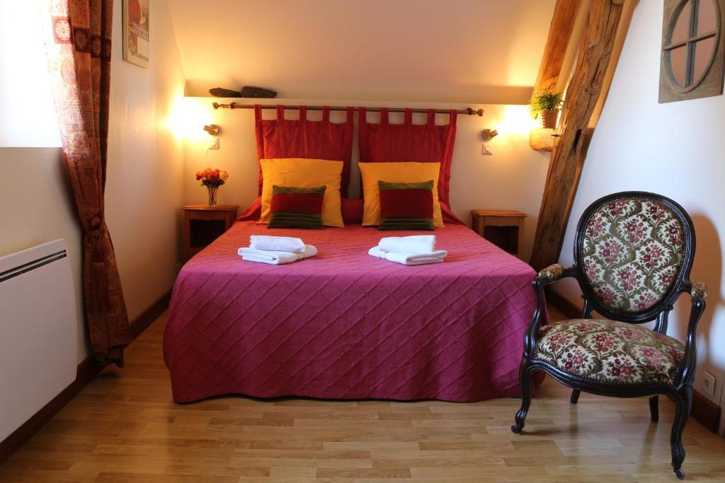 Un ou plusieurs lits dans un hébergement de l'établissement Gîte la Tanière Confort