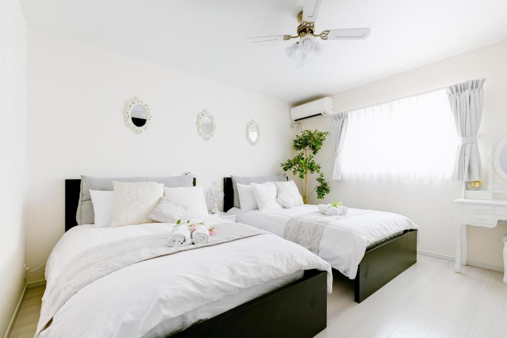 A bed or beds in a room at Villa de Class
