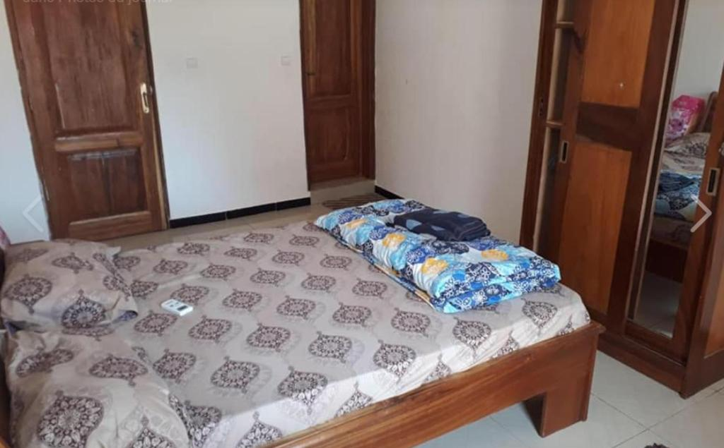 A bed or beds in a room at keur Jamm