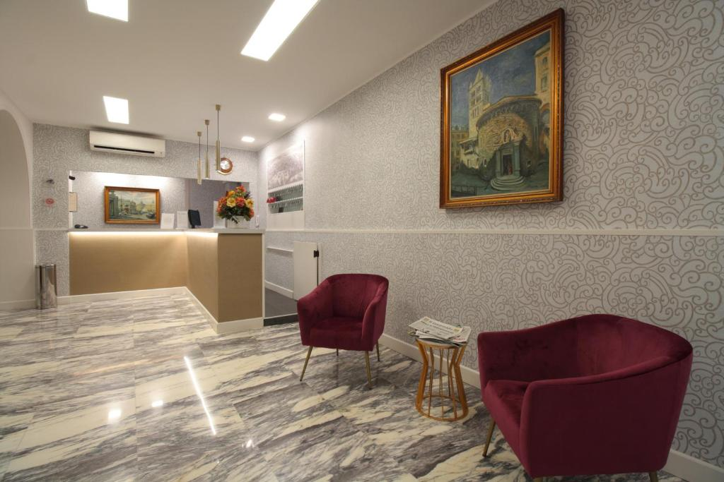 The lobby or reception area at Hotel Vittoria