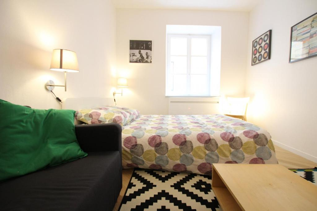 A bed or beds in a room at Colmar City Center - Quiet Studio ALSACE