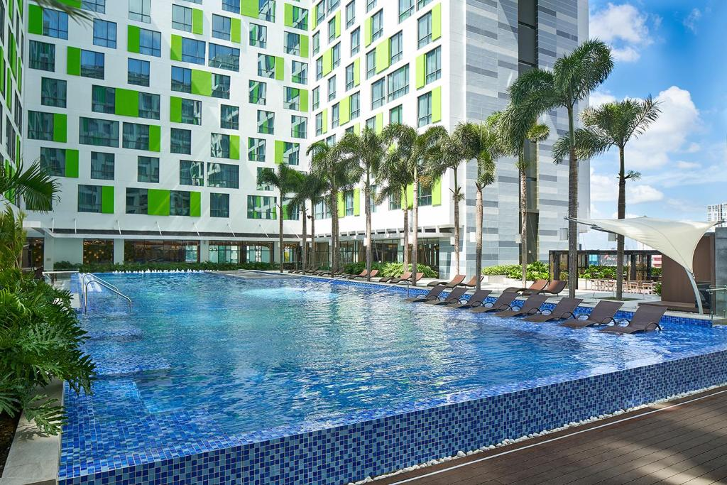 The swimming pool at or near Holiday Inn & Suites Saigon Airport