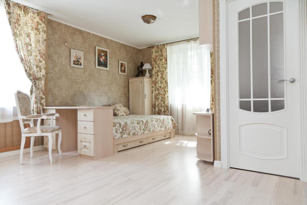 Кровать или кровати в номере Апартаменты Савеловская President