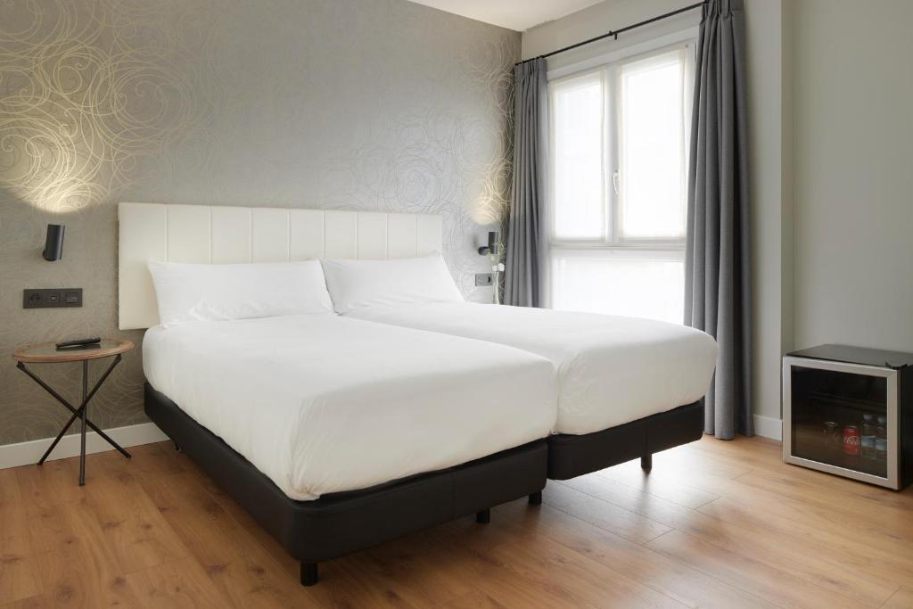 Cama o camas de una habitación en Hotel Arrizul Beach