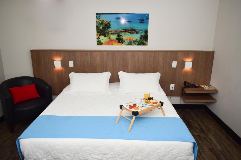 A bed or beds in a room at Camboriú Praia Hotel