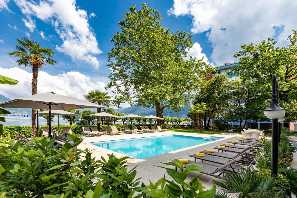 Der Swimmingpool an oder in der Nähe von H4 Hotel Arcadia Locarno