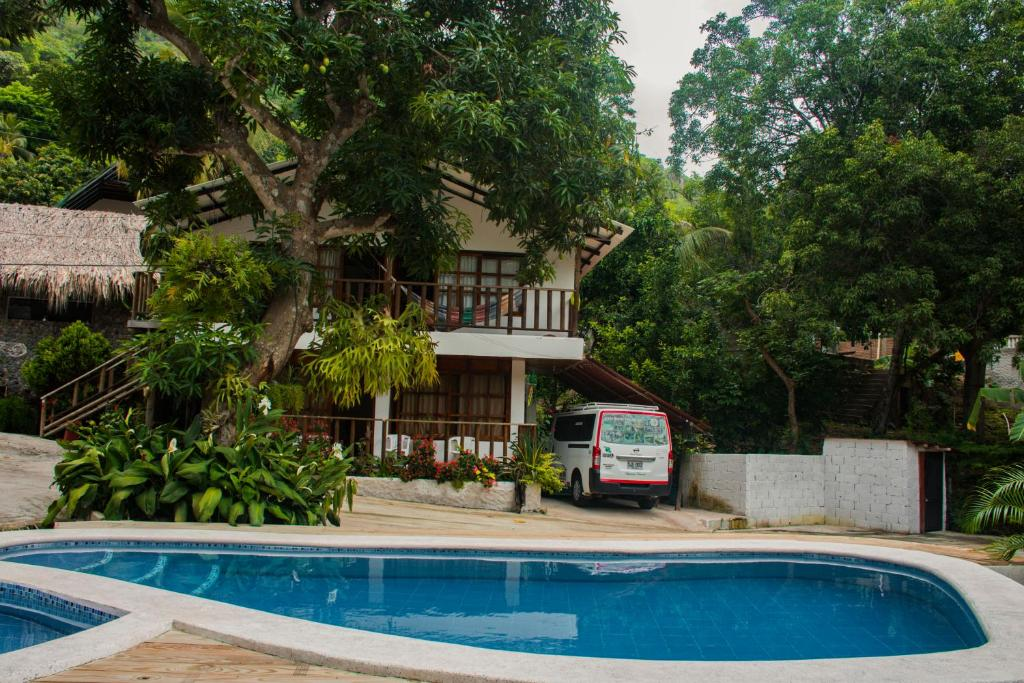 The swimming pool at or near Casa Hostal Villa Del Rio
