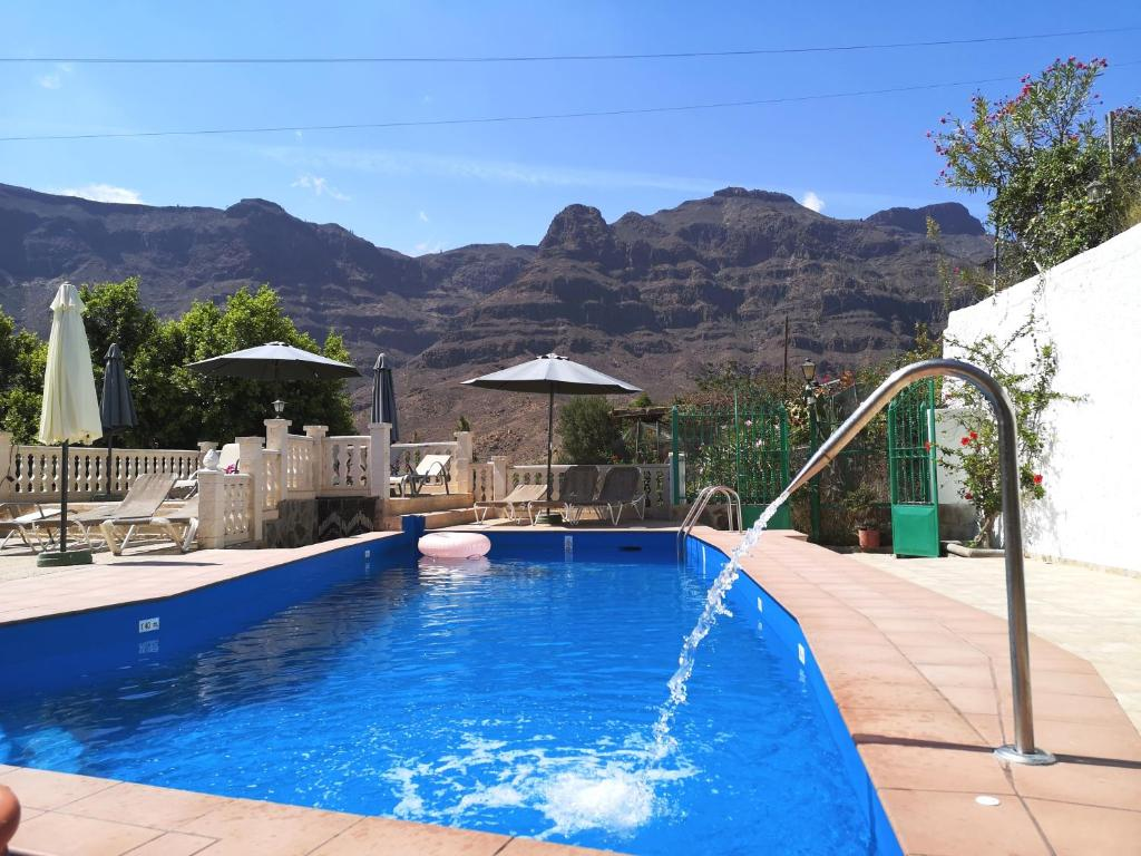 The swimming pool at or near Finca Tomás y Puri
