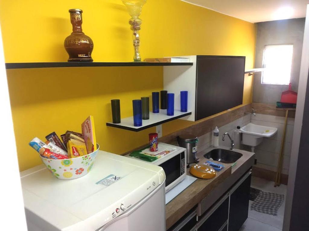 A television and/or entertainment center at Edificio de acomodacoes Simples - Varjao