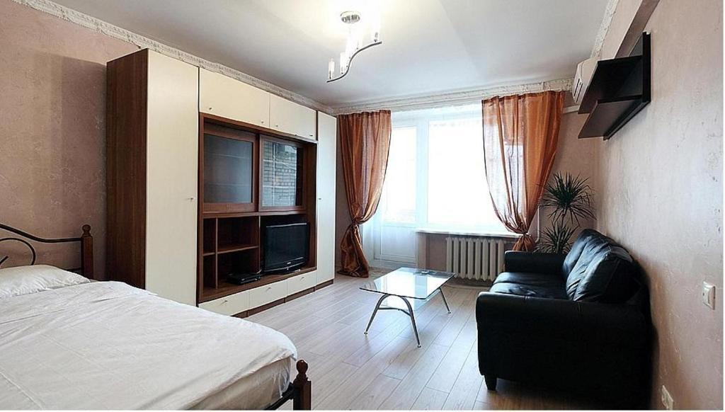 Телевизор и/или развлекательный центр в ApartLux  на Белорусской