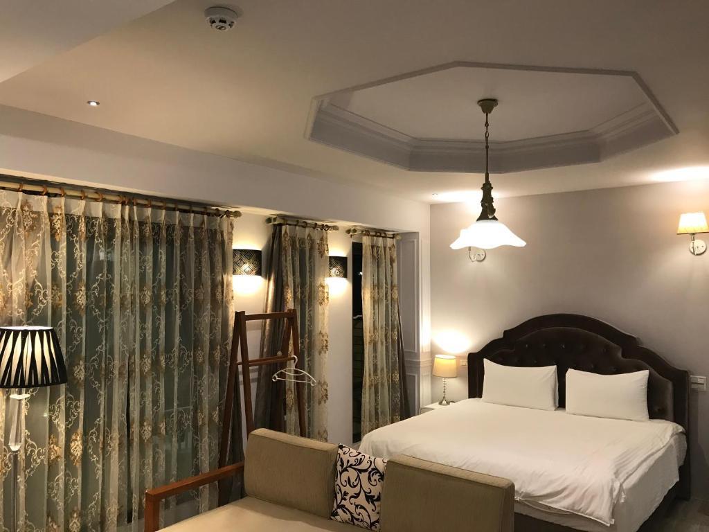 Giường trong phòng chung tại Spring Land Villa