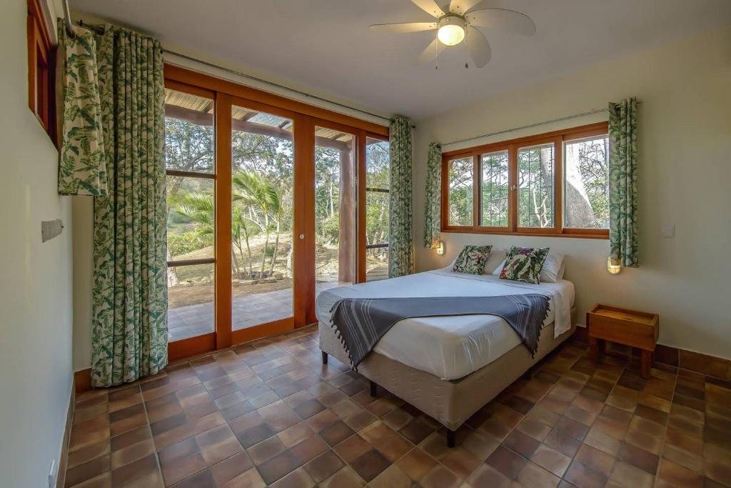 A bed or beds in a room at Jungalow, a secluded property surrounded by nature