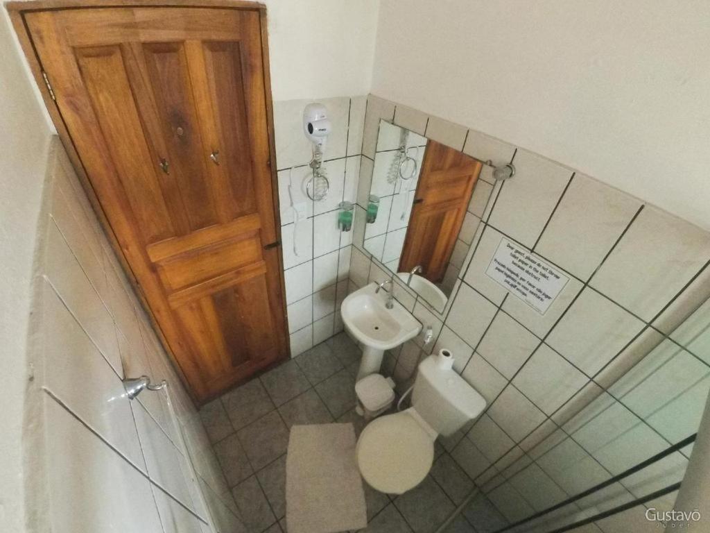Um banheiro em Pousada Pouso do Campo