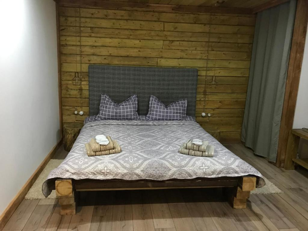 A bed or beds in a room at Guest house Alphouse