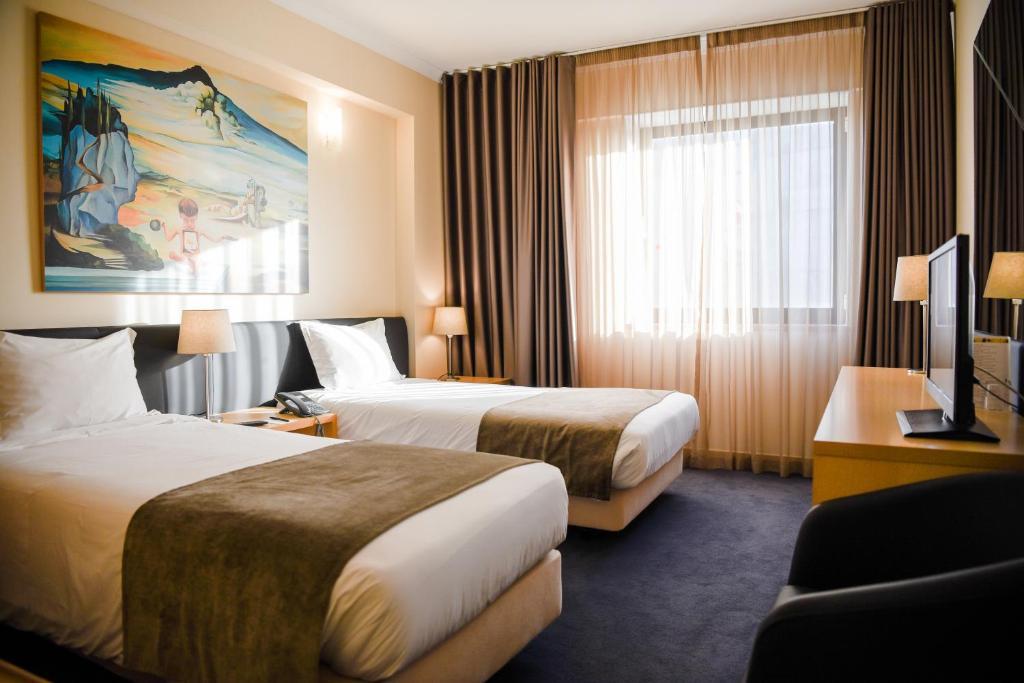 Uma cama ou camas num quarto em Hotel 3K Barcelona