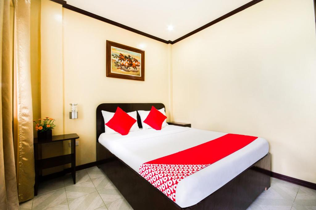 A bed or beds in a room at Bans Beach Resort