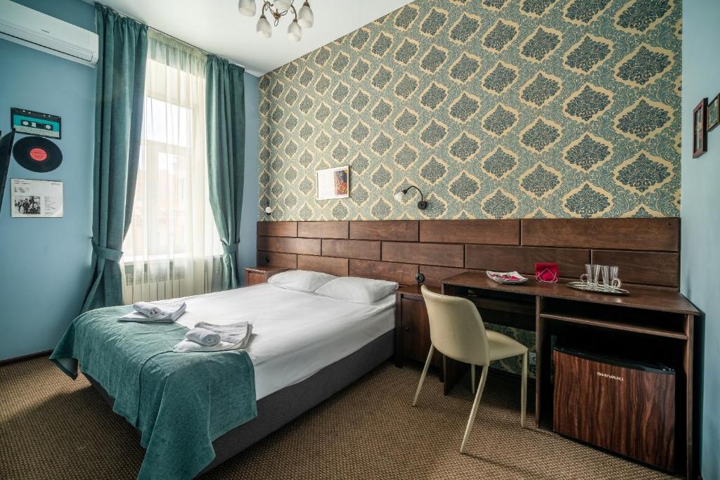 Кровать или кровати в номере Отель Рубинштейна 30