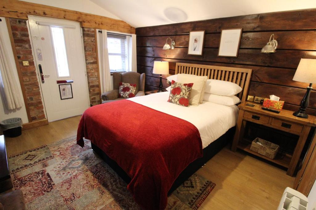 A bed or beds in a room at Boutique Garden Lodge @ The Larches