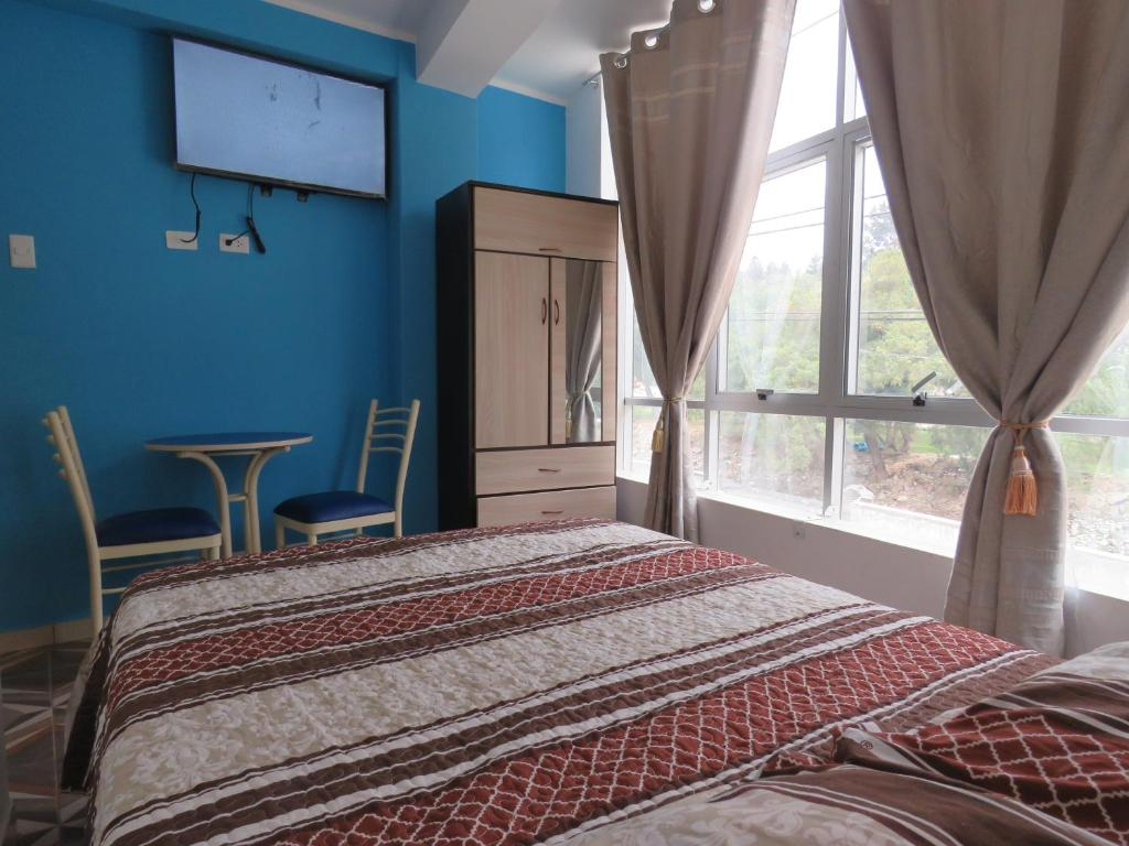 A bed or beds in a room at HOSTAL SKY