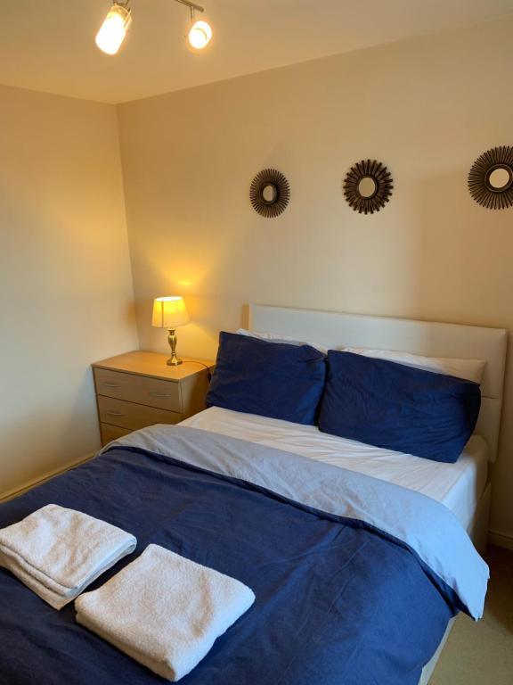 A bed or beds in a room at The Hawkes