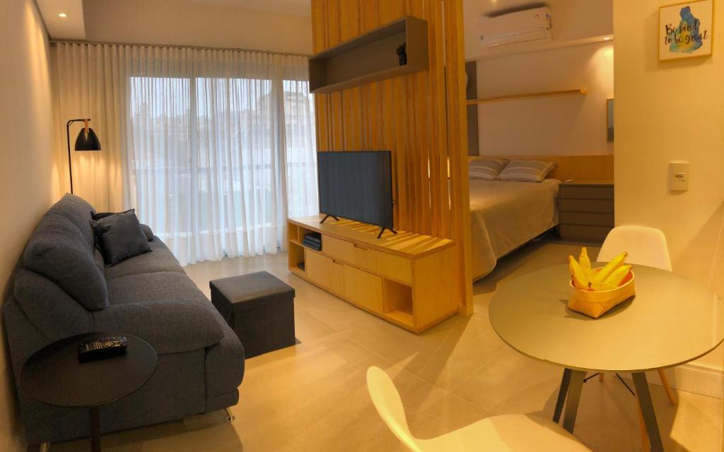 A seating area at Studio Sofisticado Trend 24 Moinhos de Vento