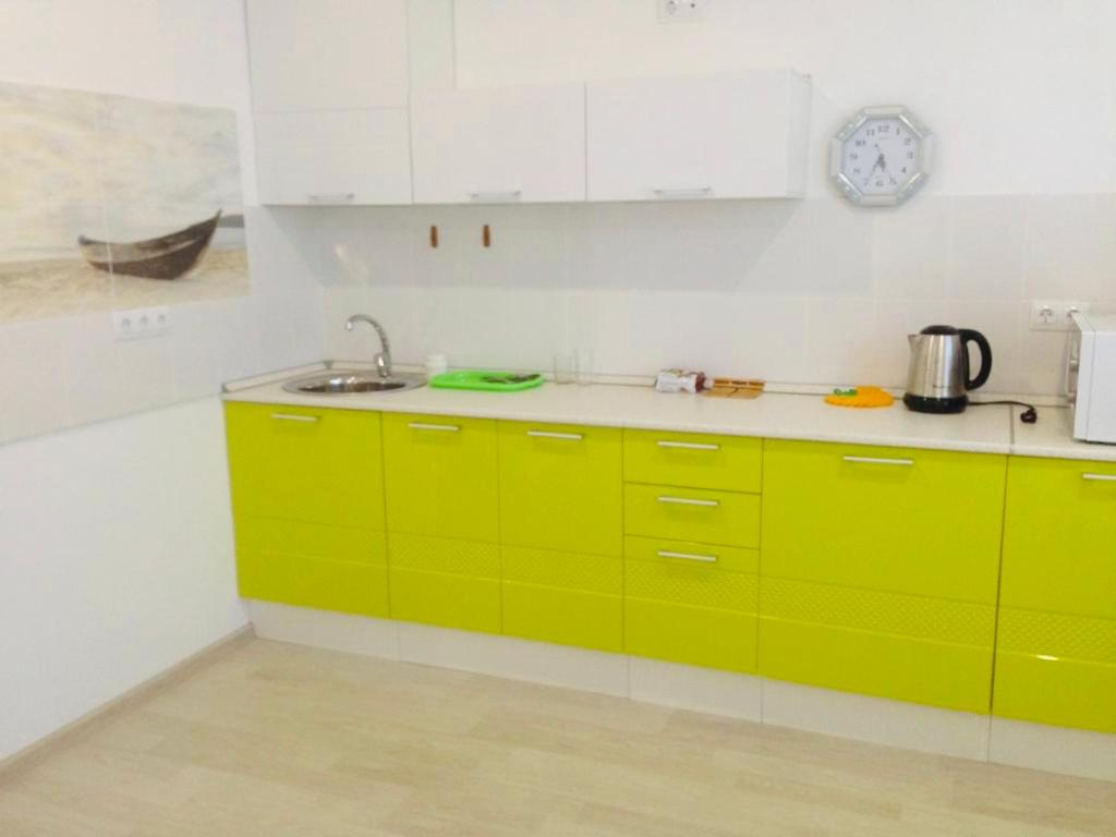 A kitchen or kitchenette at Апартаменты «Татьяна»