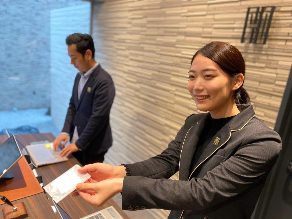 Staff members at Randor Residential Hotel Sapporo Suites