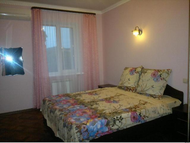 Кровать или кровати в номере Гостинечный комплекс Аракс