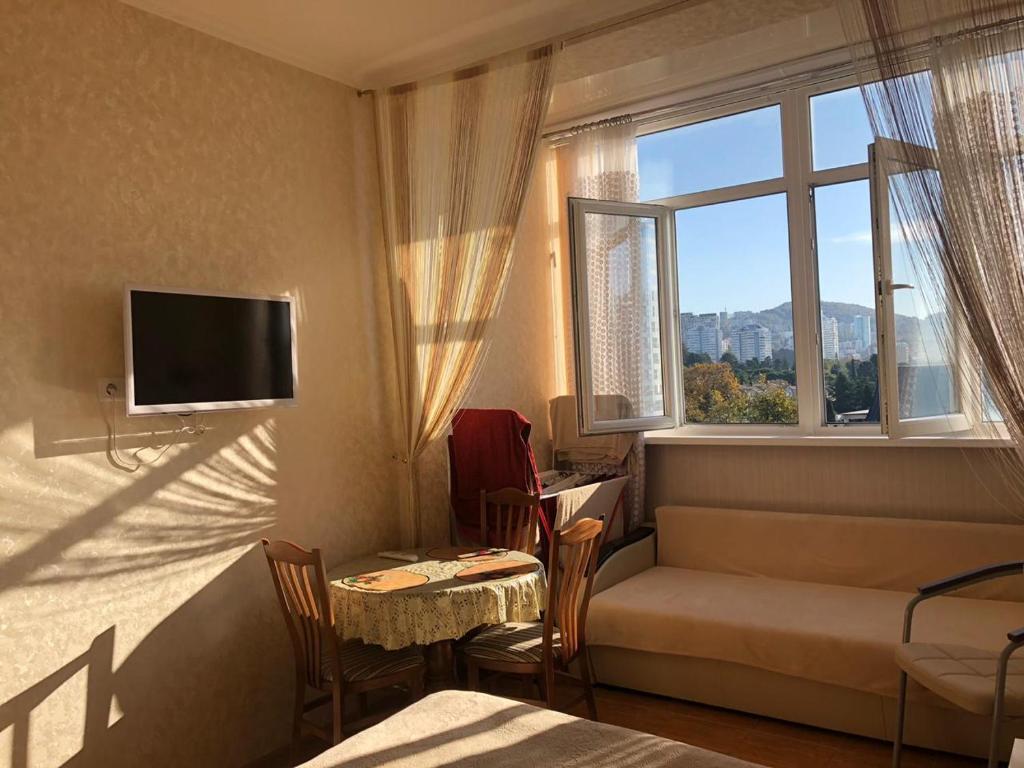 Гостиная зона в Апартаменты Светлана на Курортном