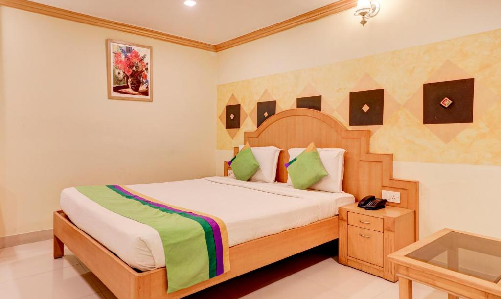 A bed or beds in a room at Treebo Trend Terminus