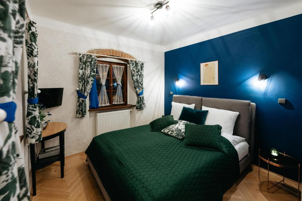 A bed or beds in a room at Boutique Hotel Romantick