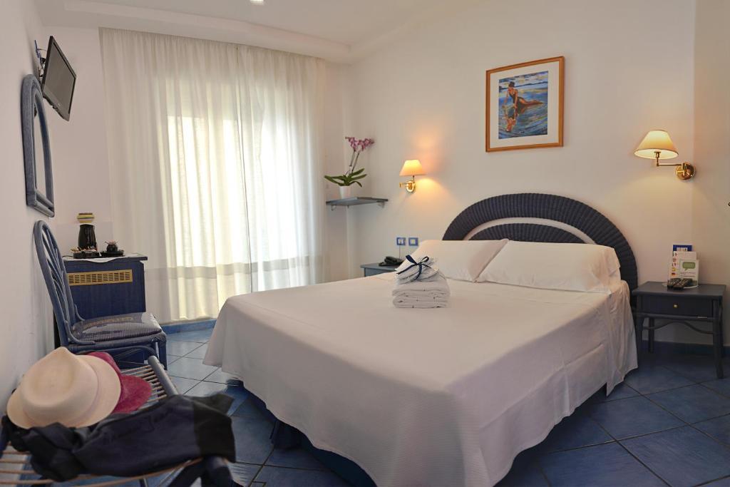 Letto o letti in una camera di Hotel Pensione Reale