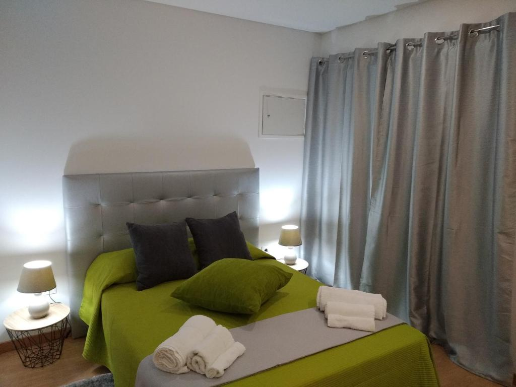 A bed or beds in a room at Casa Do Boteco