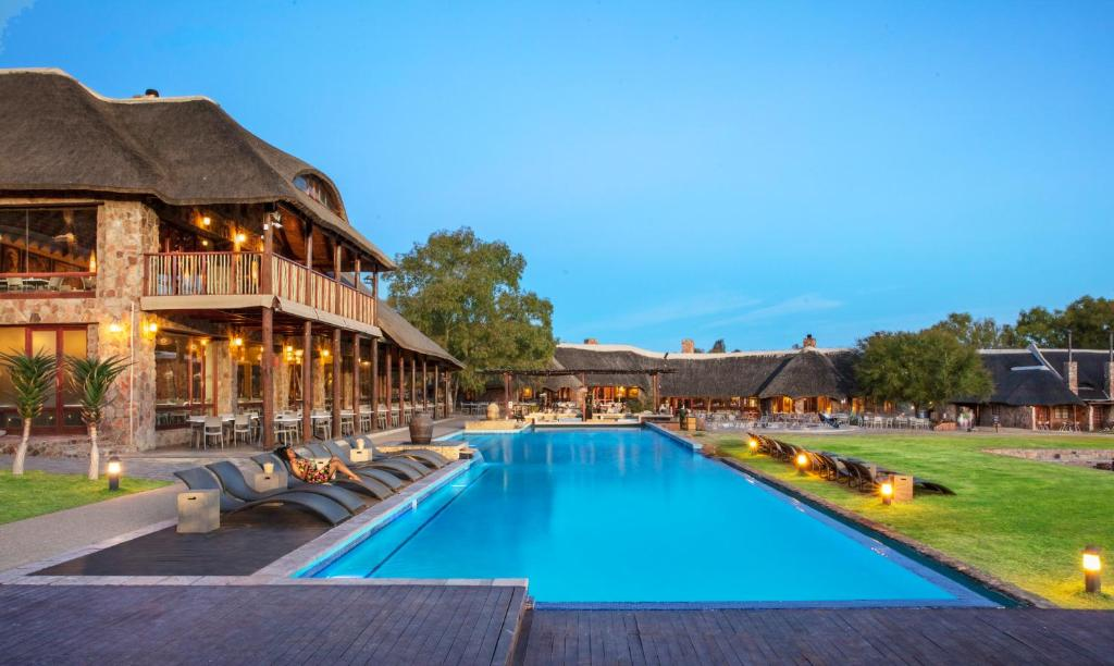 The swimming pool at or close to Aquila Private Game Reserve & Spa