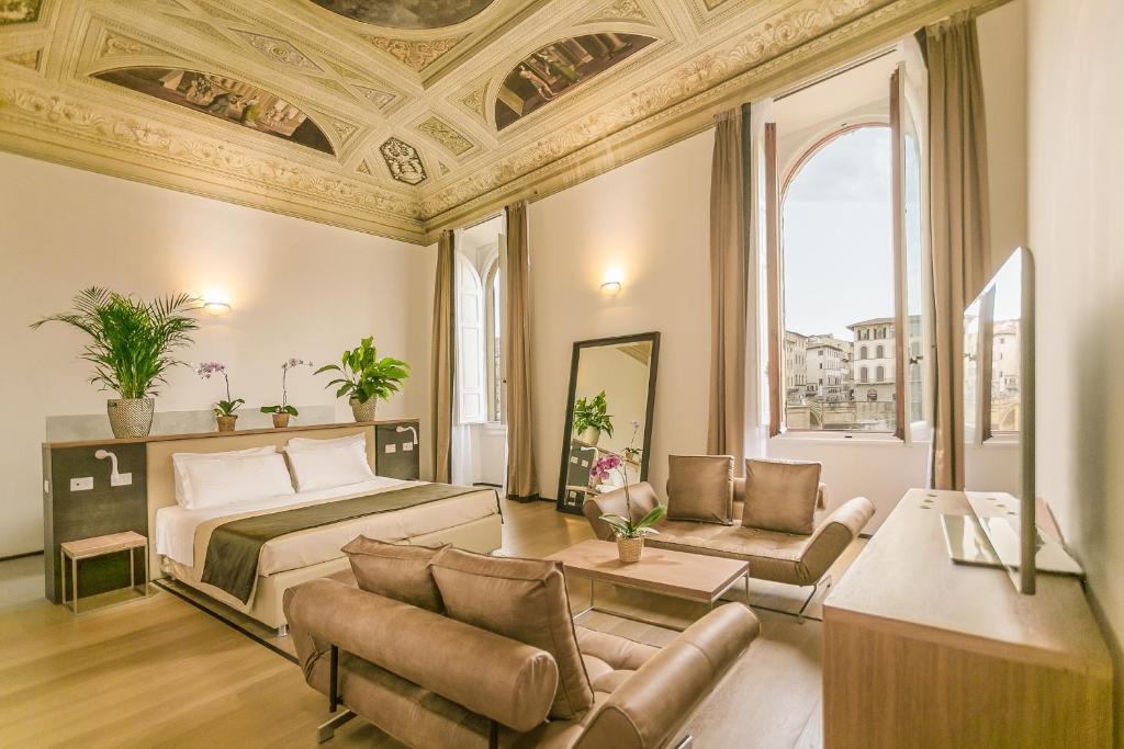 A seating area at Alfieri Signature Suites - Alfieri Collezione