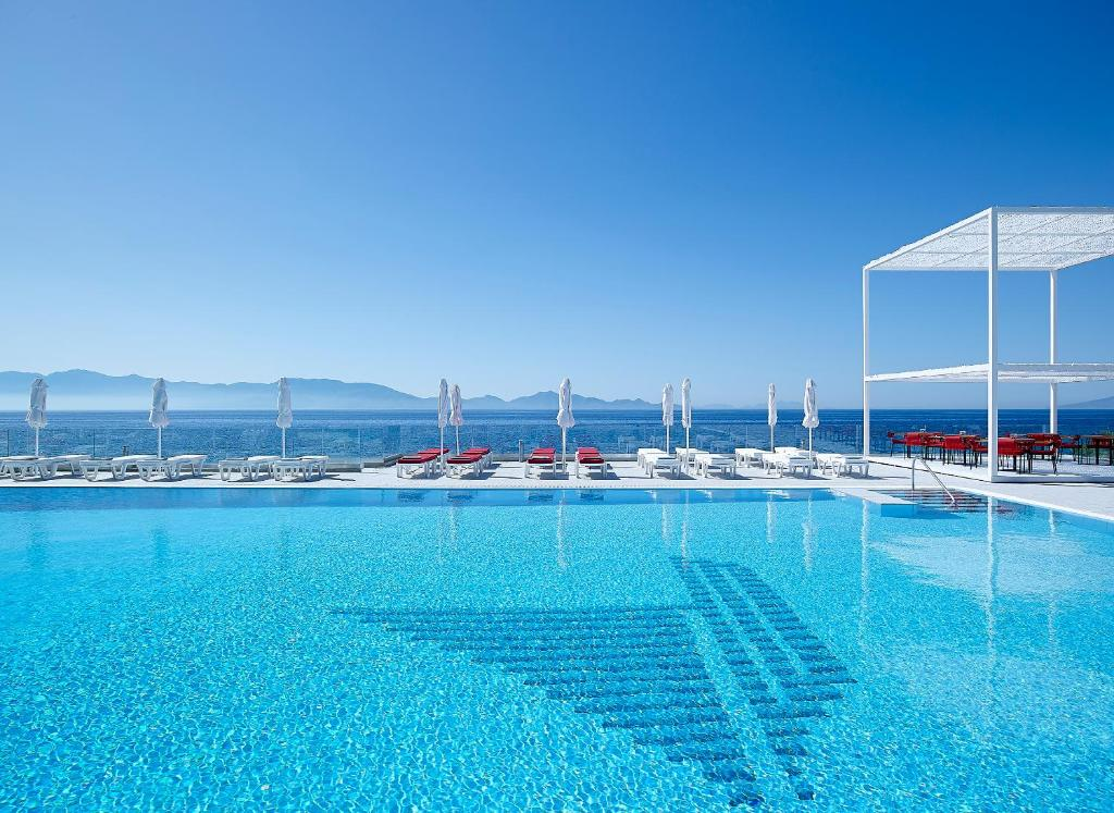 The swimming pool at or near Dimitra Beach Hotel & Suites