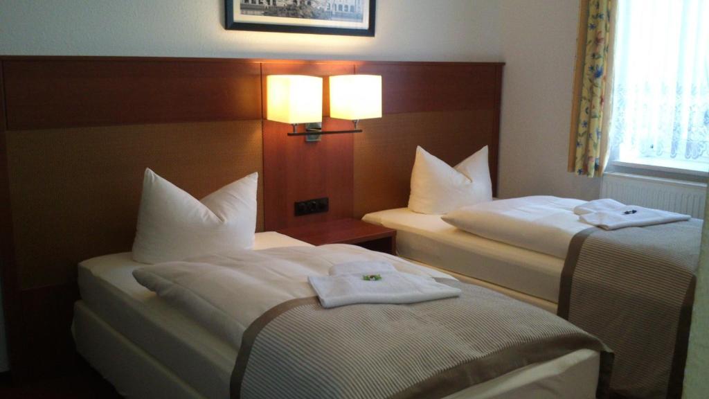 Ein Bett oder Betten in einem Zimmer der Unterkunft Hotel Boizenburger Hof