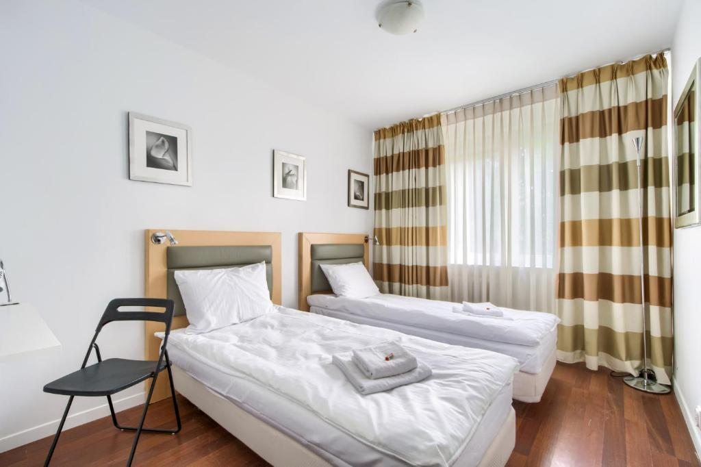 Lova arba lovos apgyvendinimo įstaigoje Zamiany Rooms, metro Ursynow by 404 Rooms & Apartments