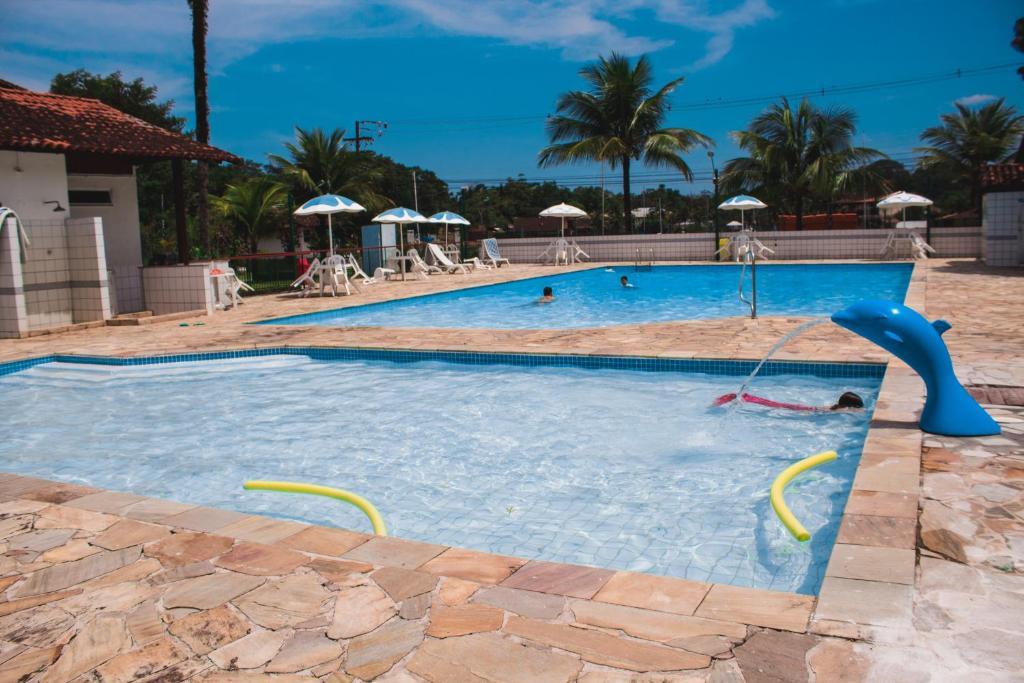 The swimming pool at or close to Apt 2 qts em Condominio Praia Piscina Marina