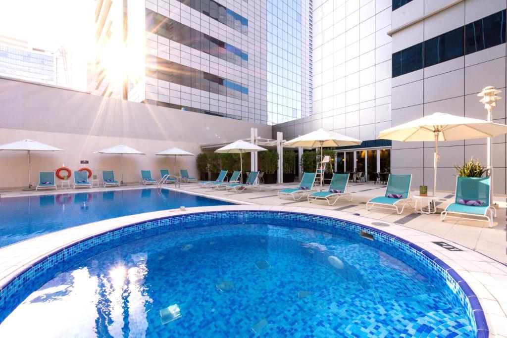 The swimming pool at or near Premier Inn Abu Dhabi Capital Centre