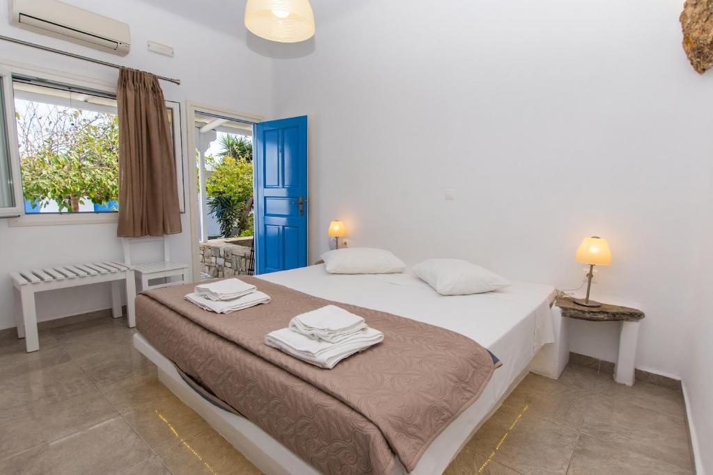 Un ou plusieurs lits dans un hébergement de l'établissement Mykonos Vouniotis Rooms