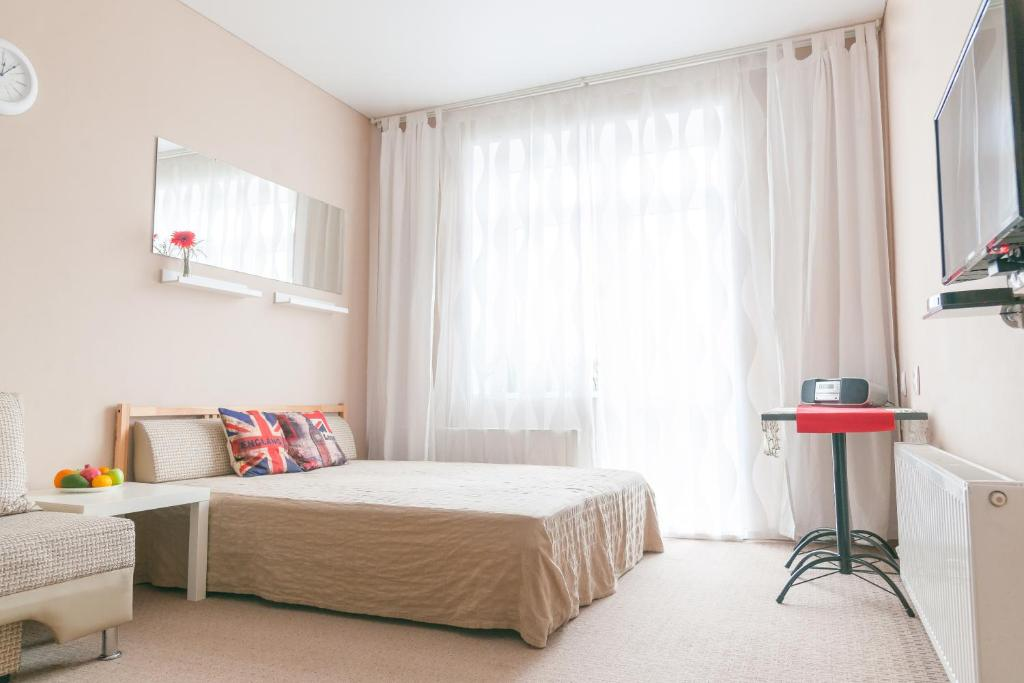 Кровать или кровати в номере Апартаменты с видом на горы