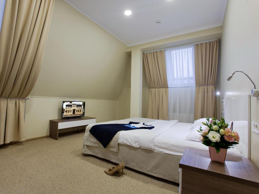 Кровать или кровати в номере Отель Платов