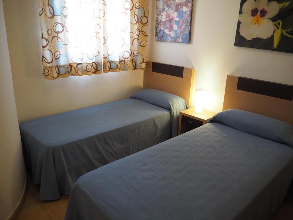 Cama o camas de una habitación en Apartamentos Turisticos Aguilas de los Collados