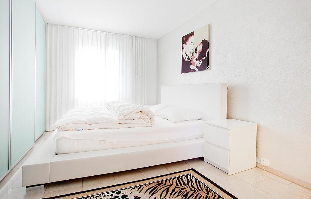 Ein Bett oder Betten in einem Zimmer der Unterkunft Junior Suite Apartment by Livingdowntown