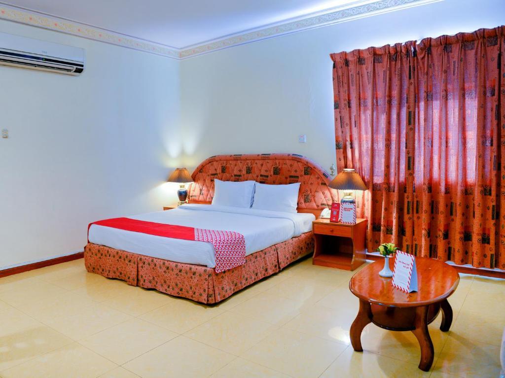 Ein Bett oder Betten in einem Zimmer der Unterkunft OYO 103 Hotel Golden Oasis