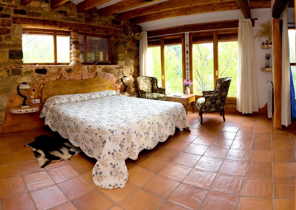 Cama o camas de una habitación en Masía La Posada Del Río Carbo